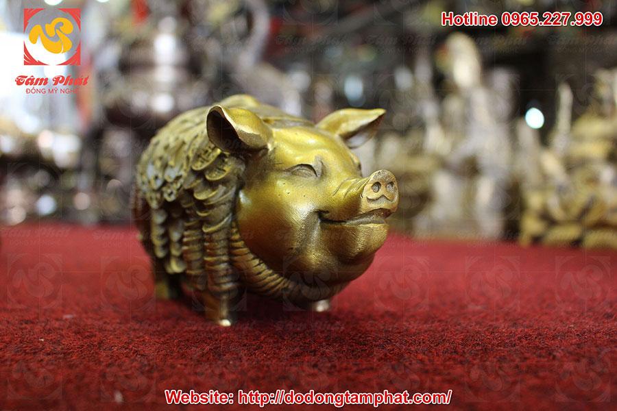 Tượng heo phong thủy cõng tiền vàng